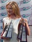 What Awards holds Céline in her hands?