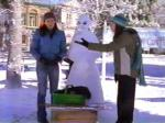 While building a snowman in The Bracebridge Dinner, what movie does Rory say they have to rent?