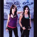 What instrument do both members of The Veronicas play, but only one plays live?