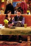 What does Chandler suggest to Monica as a decoration for their bedroom when he moves into her apartment?