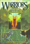 Which three warrior cats did Rusty first meet?