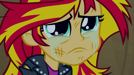 Who lends Sunset Shimmer a hand while she cries at the end of the Equestria Girls movie?
