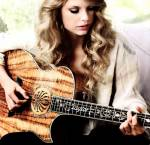 Who taught Taylor her first chords on the guitar?