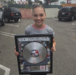 Maddie has over a billion views on Youtube starring in which singer's videos?