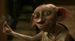 What piece of clothing does Lucius free Dobby with?