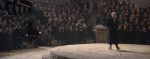In a deleted scene, when Grindelwald and his followers are in the rally, What does an anonymous wizard says? (You can watch the video here: https://ww