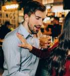 You are in the bar and drink your cocktail when a very athletic guy sit down by you. He is drunk and a little bit rude. He tells you that he wanna som